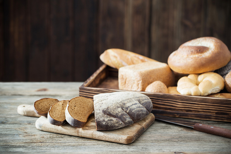 different types of bread on dark wooden background 스톡 콘텐츠