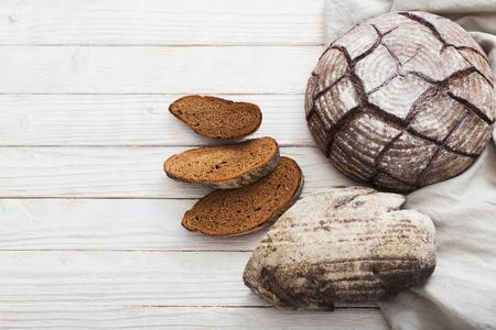 homemade bread on  white wooden background