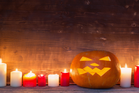 Halloween pumpkin on old wooden background Banco de Imagens