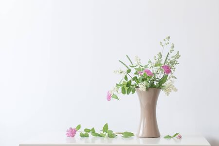 summer flowers in vase on table