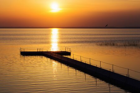pontoon pier at beautiful summer sunset