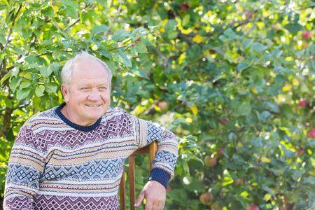 portrait of  elderly man in  sunny garden