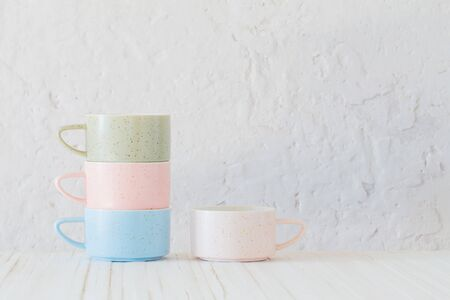 modern ceramic cups on background white wall