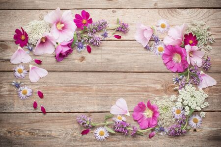 summer flowers on old wooden background