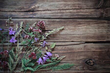 wildflowers on dark old wooden background