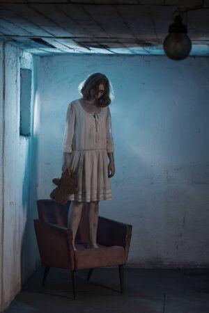 scary girl in white dress from horror film in  room 版權商用圖片