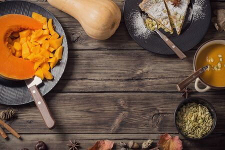 pumpkin dishes on old wooden background