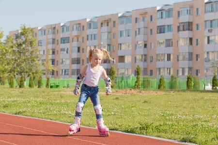 little girl rollerblading rides in stadium
