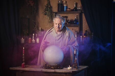 elderly wizard  with crystal ball