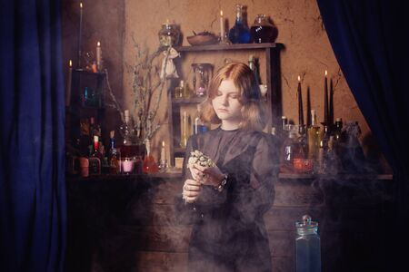 young witch in home. Halloween concept