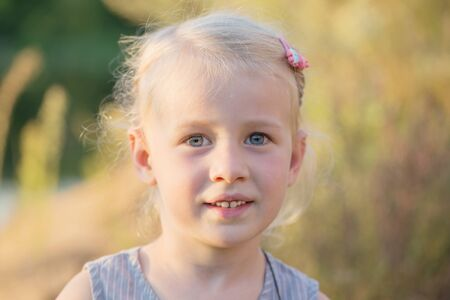 beautiful little blonde smile  girl close up Stock fotó