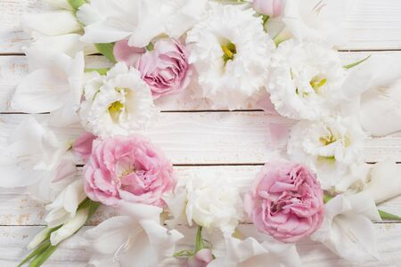 pink and white flowers on white wooden background