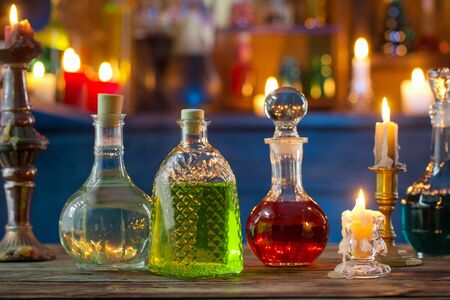 magic potions in bottles on wooden background