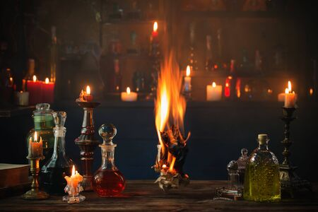 old burning paper with potions on old wooden table