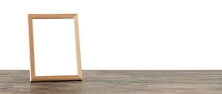 wooden frame on wooden table on white background Фото со стока - 129781254