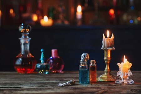 magic potions in bottles on wooden table