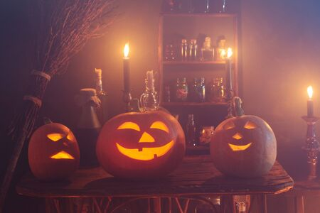 Halloween decoration with pumpkins and magic potions indoor Foto de archivo