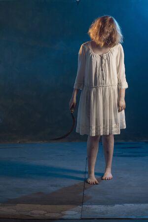 scary girl in white dress from horror film in  room Reklamní fotografie