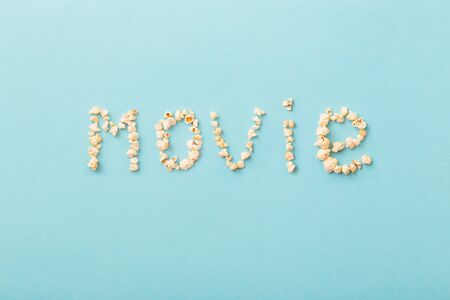word movie made of popcorn on  blue background