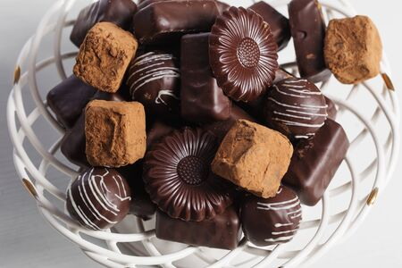 chocolate candy on plate on white table Stockfoto