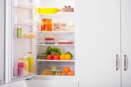 white refrigerator with different food Zdjęcie Seryjne