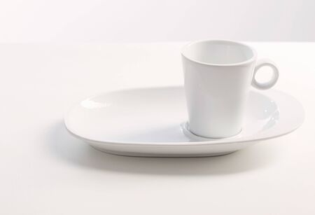 white cup on white white background