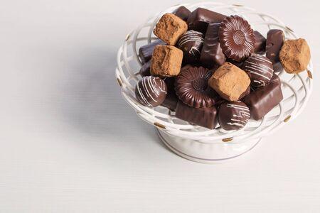 chocolate candy on plate on white table Reklamní fotografie