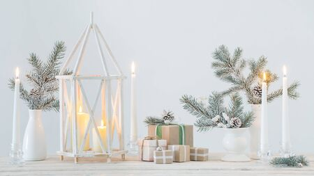 white Christmas decorations with burning candles