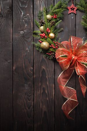 Christmas wreath on dark wooden door