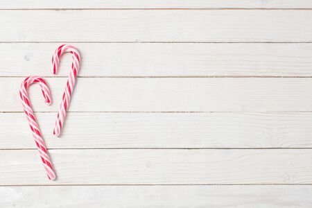 candy cane on white wooden background Stock Photo