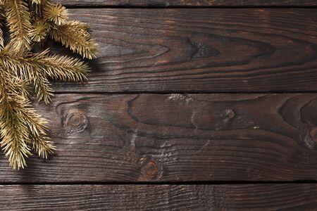 Christmas fir branches on old dark wooden background