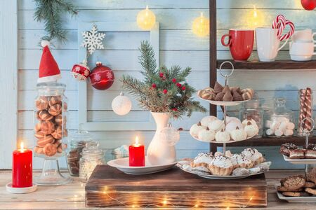 Christmas bar cacao decoration with cookies and sweets on blue wooden background in vintage style