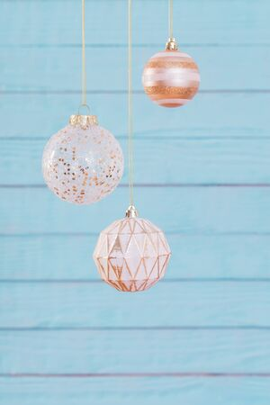 Christmas balls hanging  on  blue wooden background