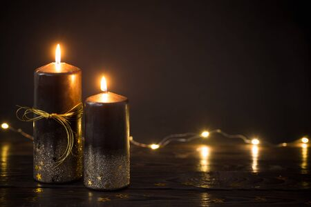 black Christmas candles on dark background