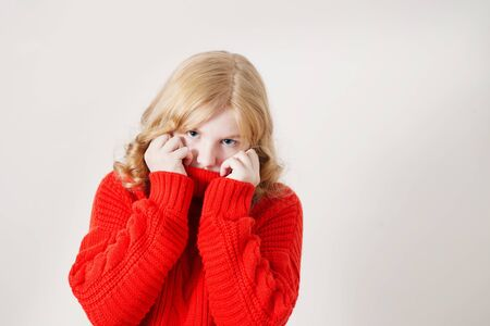 teen girl in red sweater on white background