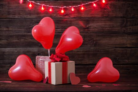 heart shaped red  balloons on old wooden background Banco de Imagens