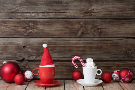 Christmas red and white decor on old wooden background