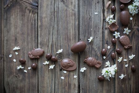 chocolate Easter eggs on dark wooden background Stock Photo - 138076391