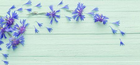 blue cornflowers on wooden background Reklamní fotografie
