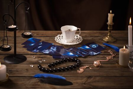 fortune-telling with  cup of coffee and fortune-telling cards on old wooden table