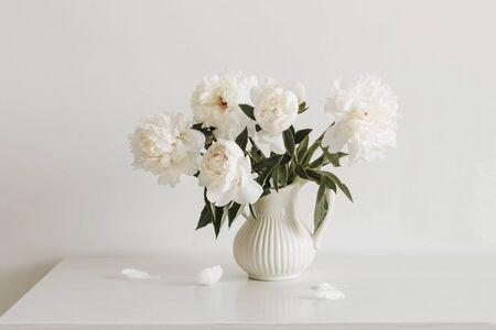 peonies flowers in vase on white background Banco de Imagens