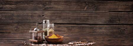 spices on old dark wooden background