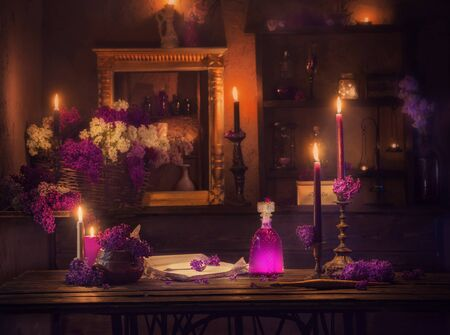 magic potion of lilac flowers in the witch's house Stock Photo