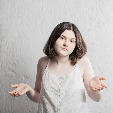 teenager girl on background white wall Archivio Fotografico - 150125361