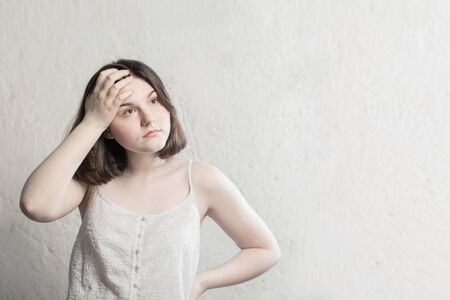 teenager girl on background white wall Archivio Fotografico - 150124556