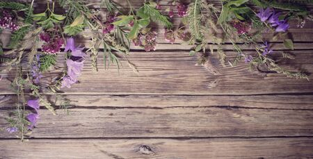 wildflowers on dark old wooden background