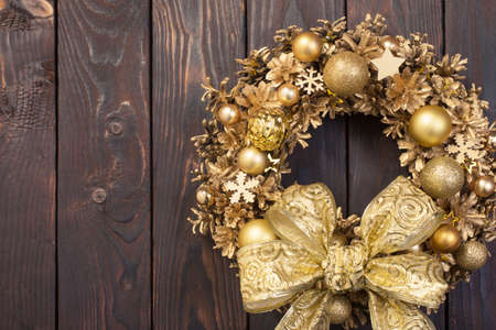 Christmas wreath on old wooden background