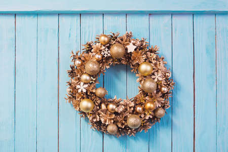 Christmas wreath on old blue wooden background