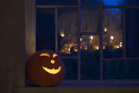 Halloween pumpins on windowsill at the night