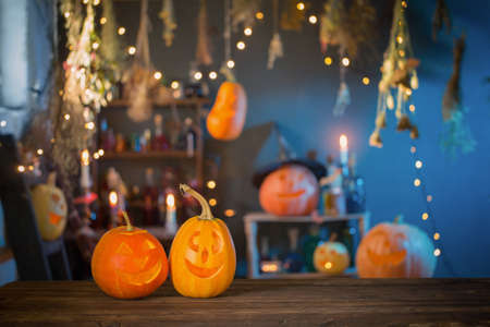 Halloween pumpkins on old wooden table on background Halloween decorations Foto de archivo - 155696473